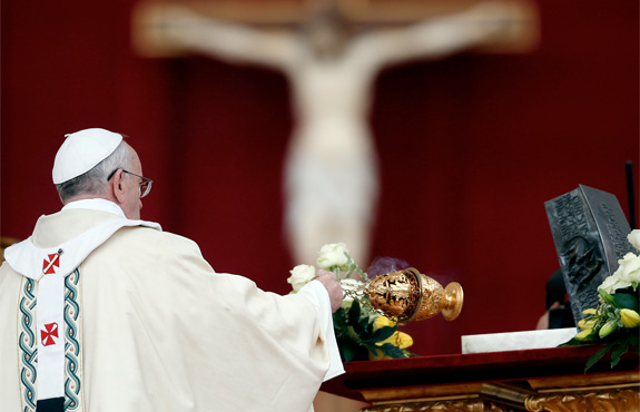 Pope Francis censes the relics of St. Peter the Apostle on the altar during a Mass in St. Peter's Square at the Vatican Nov. 24. The bone fragments