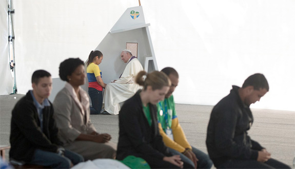Pope Francis hears the confession of a young woman during World Youth Day in Rio de Janeiro July 26. (CNS photo/L'Osservatore Romano)