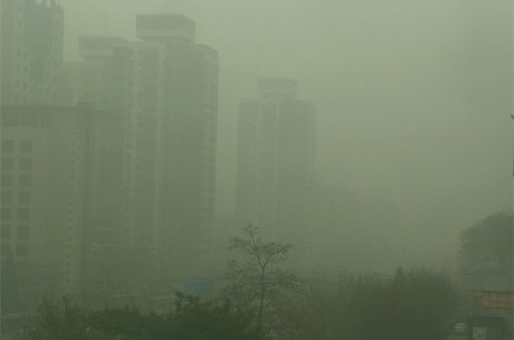 Beijing smog outside apartment widow