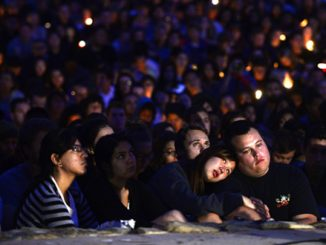 People gather at a park May 24 for a candlelight vigil for the victims of a killing rampage in the town of Isla Vista