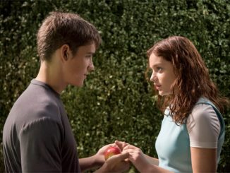 Brenton Thwaites and Odeya Rush star in a scene from the movie 'The Giver'. (CNS photo/courtesy The Weinstein Company)