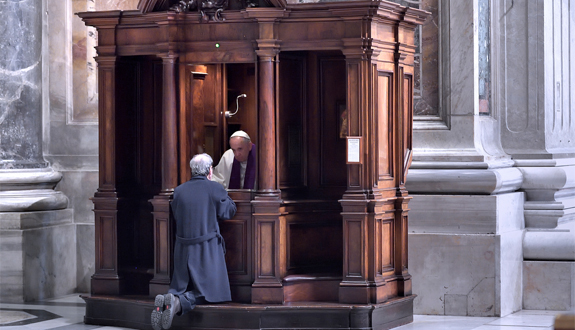 Pope Francis hears confessions during a Lenten penance service in St. Peter's Basilica at the Vatican March 13. During the service the pope announced an extraordinary jubilee