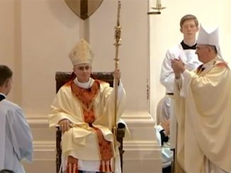 bishop thomas a. daly receives his cathedra at his installation mass at our lady of lourdes cathedral