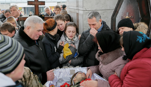 Ukrainians attend a funeral in Kiev Feb. 2 for a serviceman killed in the eastern Ukrainian conflict with Russia. (CNS photo/Sergey Dolzhenko