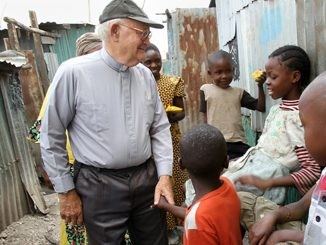 Maryknoll Father John Lange as he visits sick residents in Mukuru Kwa Njenga slum in Nairobi
