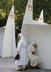 A nun looks in a confessional at one of the 200 temporary structures set up at Madrid's Buen Retiro park ahead of World Youth Day in Madrid Aug. 12.  (CNS photo/Andrea Comas