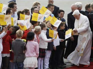 pope benedict xvi is greeted by children after he arrived at tegel airport in berlin sept. 22.
