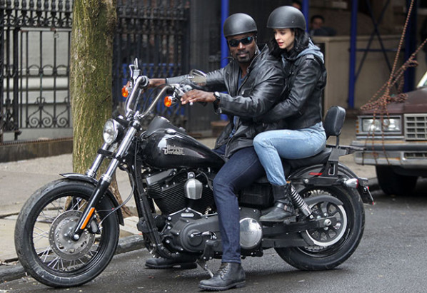 "NEW YORK, NY - APRIL 14: Mike Colter as Luke Cage and Krysten Ritter as Jessica Jones filming Marvel / Netflix's ""Jessica Jones"" filming in Brooklyn on April 14, 2015 in New York City. (Photo by Steve Sands/GC Images)"