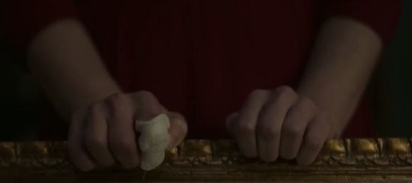 The Handmaid's Tale Offred gripping Waterford couch