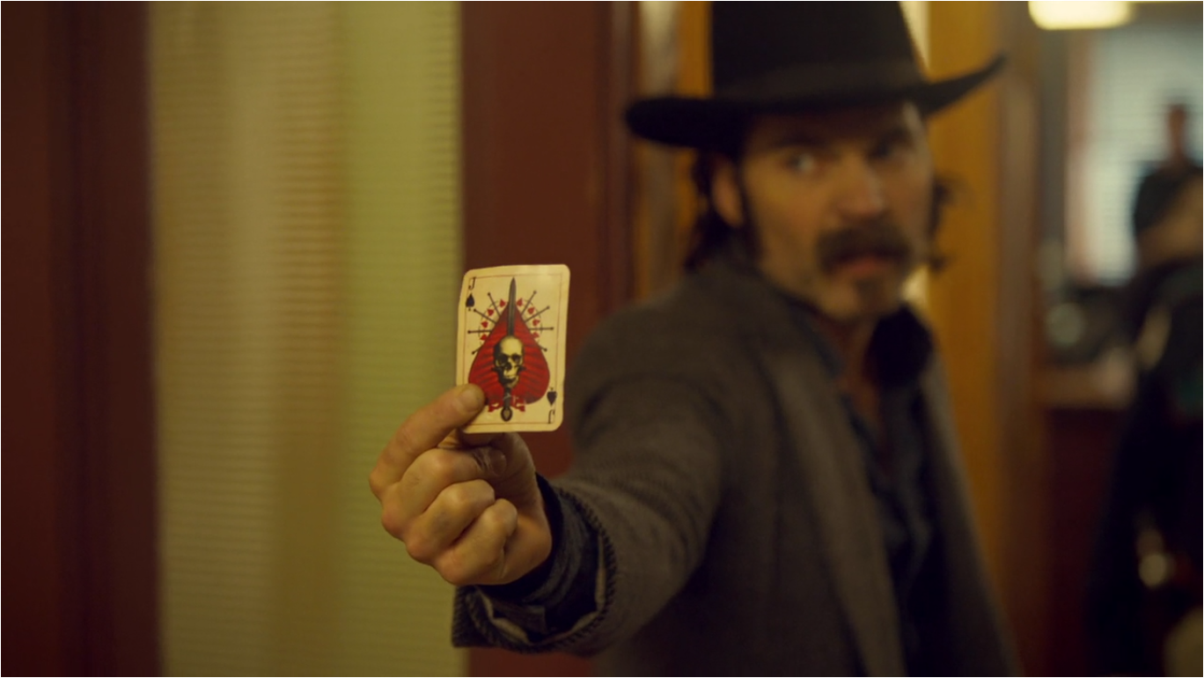 Wynonna Earp Two-Faced Jack Doc Holding Jack of Spades Card