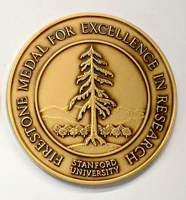 Round bronze Firestone medal, image of the Stanford tree