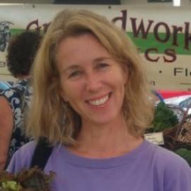 Alissa Keny-Guyer at farmer's market in lavendar shirt