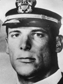 Attached photograph of Commander Arnold