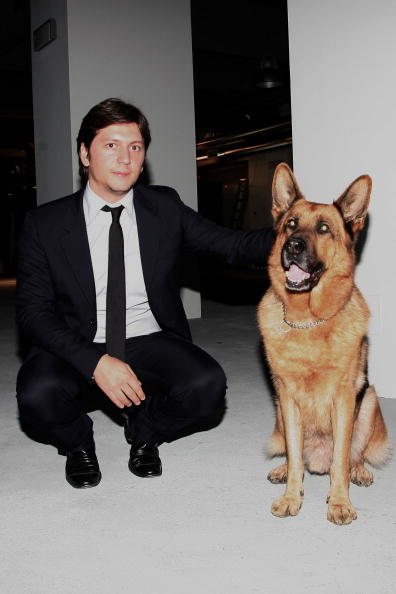 ROME - DECEMBER 16: Vice president of Belstaff Michele Malenotti, poses with the dog Rex during the 'Belstaff Presents New Uniforms For Italian Police' at the Direzione Generale di Pubblica Sicurezza on December 16, 2009 in Rome, Italy. (Photo by Franco Origlia/WireImage)