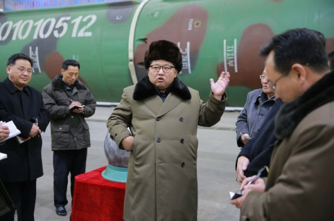 This undated picture released from North Korea's official Korean Central News Agency (KCNA) on March 9, 2016 shows North Korean leader Kim Jong-Un (C) meeting with the scientists and technicians in the field of researches into nuclear weapons and guiding the work for boosting the  nuclear arsenal at an undisclosed location. / AFP / KCNA / KCNA