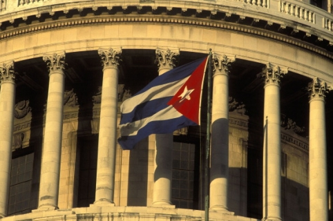 CUBA - CIRCA 1900:  The national capitol in Havana, Cuba - The national flag.  (Photo by Gerard SIOEN/Gamma-Rapho via Getty Images)
