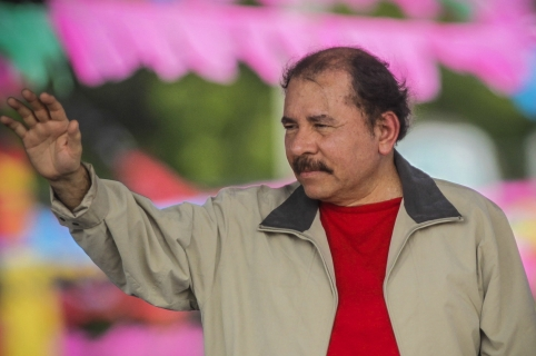 Nicaraguan President Daniel Ortega waves to Sandinista supporters in Managua during the 36th anniversary of the ''El Repliegue'' tactical retreat from Managua to Masaya, on July 3, 2015. Sandinistas commemorated the historical military maneuver that allowed the Sandinista guerrilla forces to regroup and later overthrow the dictatorship of Anastasio Somoza in 1979. AFP PHOTO/Inti Ocon / AFP / Inti Ocon