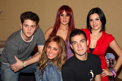 "MIAMI BEACH, FL - OCTOBER 17:  (L-R)  Christopher Alexander Luis Casillas Von Uckermann, Anahi Giovanna Puente Portillo, Dulce Maria Espinoza Savinon, Alfonso ""Poncho"" Herrera Rodriguez and Maite Perroni Beoriequi of the group RBD pose during a press conference on October 17, 2006 in Miami Beach, Florida.  (Photo by Alexander Tamargo/Getty Images)"
