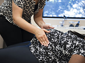 chiropractor caring for pregnant belly