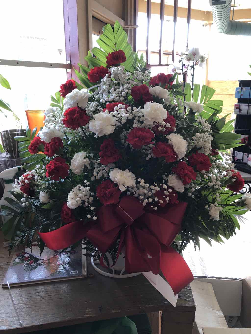 Red and White Handled Basket by Fasan Florist