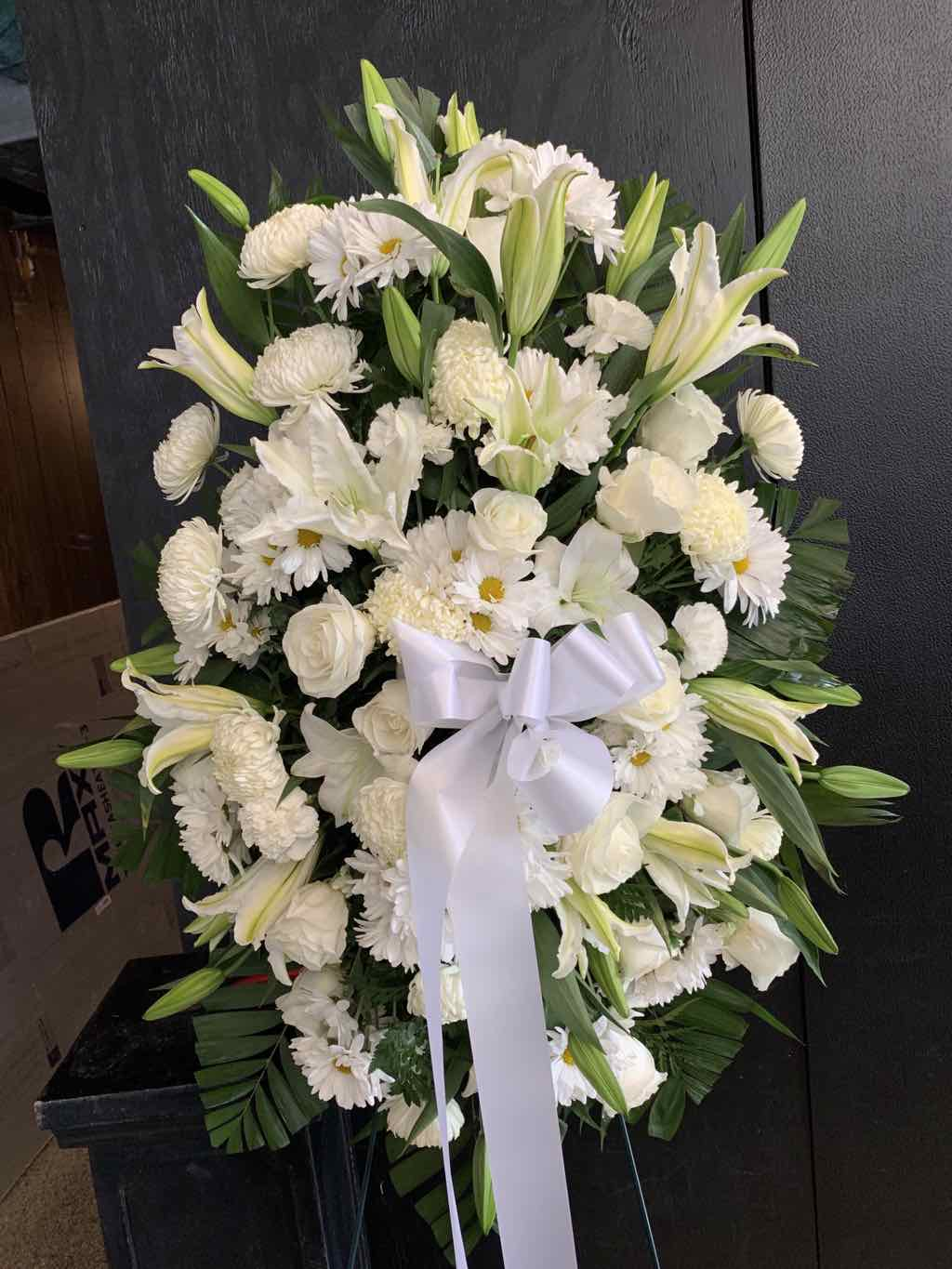 Exquisite Tribute Standing Spray by Fasan Florist