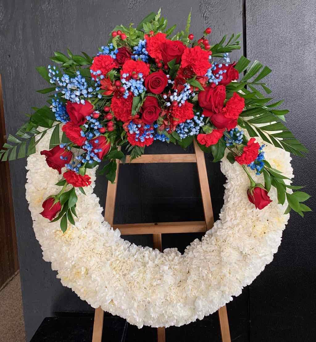 Reflections of Glory Wreath by Fasan Florist