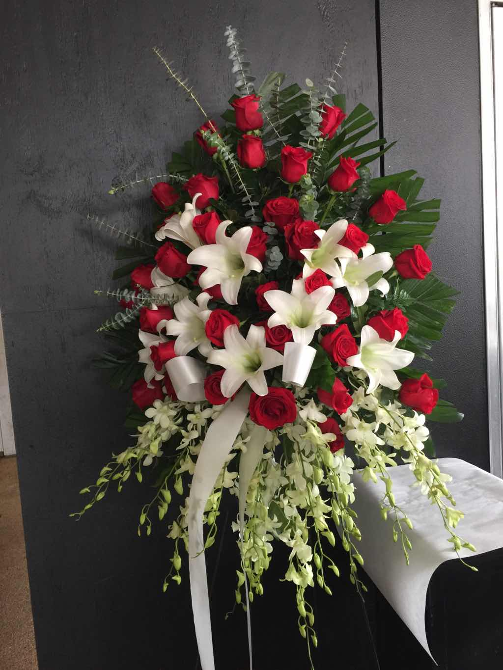 Lily and Rose Tribute Spray by Fasan Florist