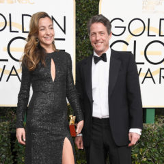 BEVERLY HILLS, CA - JANUARY 08:  Actor Hugh Grant (R) and producer Anna Elisabet Eberstein attend the 74th Annual Golden Globe Awards at The Beverly Hilton Hotel on January 8, 2017 in Beverly Hills, California.  (Photo by Frazer Harrison/Getty Images)