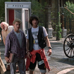 Dan Shor, George Carlin, Alex Winter, Keanu Reeves in BILL & TED'S EXCELLENT ADVENTURE (Orion Pictures Corporation)