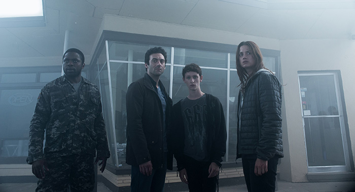 Bryan Hunt (Okezie Morro), Kevin Copeland (Morgan Spector), Adrian Garf (Russell Posner) and Mia Lambert (Danica Curcic) in The Mist (Chris Reardon for Spike)