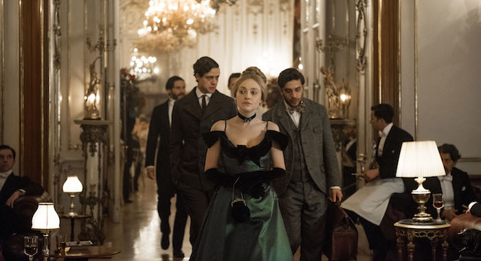 Dakota Fanning (foreground) with Daniel Bruhl, Douglas Smith, and Matthew Shear in The Alienist (Kata Vermes/TNT)