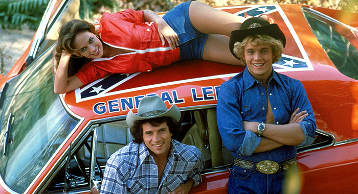 THE DUKES OF HAZZARD, Catherine Bach (top), Tom Wopat (L), John Schneider (r), 1979-1985. © CBS / Courtesy: Everett Collection
