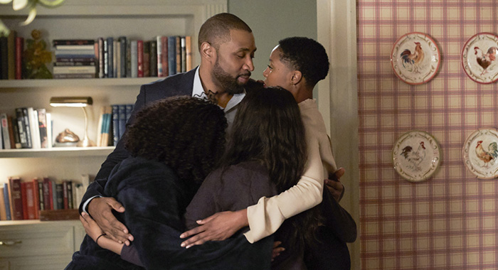 """Black Lightning -- """"Black Jesus: The Book of CrucifixionÓ -- Image BLK111B_0231b -- Pictured (L-R): Nafessa Williams as Anissa, Cress Williams as Jefferson, China Anne McClain as Jennifer, and Christine Adams as Lynn -- Photo: Bob Mahoney/The CW -- © 2018 The CW Network, LLC. All rights reserved."""