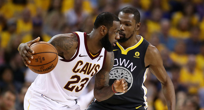 OAKLAND, CA - JUNE 03: LeBron James #23 of the Cleveland Cavaliers drives against Kevin Durant #35 of the Golden State Warriors in Game 2 of the 2018 NBA Finals at ORACLE Arena on June 3, 2018 in Oakland, California. NOTE TO USER: User expressly acknowledges and agrees that, by downloading and or using this photograph, User is consenting to the terms and conditions of the Getty Images License Agreement. (Photo by Ezra Shaw/Getty Images)