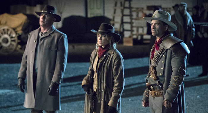"DC's Legends of Tomorrow -- ""The Good, the Bad & the Cuddly"" -- Image Number: LGN318b_0268.jpg -- Pictured (L-R): Dominic Purcell as Mick Rory/Heat Wave, Caity Lotz as Sara Lance/White Canary and Johnathon Schaech as Jonah Hex -- Photo: Jack Rowand/The CW -- 2018 The CW Network, LLC. All Rights Reserved."