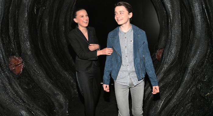 "LOS ANGELES, CA - MAY 19: Millie Bobby Brown and Noah Schnapp attend The ""Stranger Things 2"" Panel At Netflix FYSEE on May 19, 2018 in Los Angeles, California. (Photo by Charley Gallay/Getty Images for Netflix) *** Local Caption *** Noah Schnapp; Millie Bobby Brown"