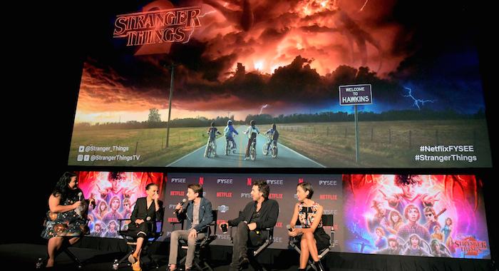 "LOS ANGELES, CA - MAY 19: Moderator Jenelle Riley, Millie Bobby Brown, Noah Schnapp, Director Shawn Levy and Casting Director Carmen Cuba speak onstage at The ""Stranger Things 2"" Panel At Netflix FYSEE on May 19, 2018 in Los Angeles, California. (Photo by Charley Gallay/Getty Images for Netflix) *** Local Caption *** Noah Schnapp; Millie Bobby Brown; Shawn Levy; Carmen Cuba; Jenelle Riley; Jenelle Riley"