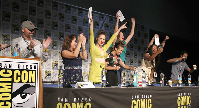 "COMIC-CON INTERNATIONAL: SAN DIEGO -- ""Wynonna Earp Panel"" -- Pictured: (l-r) Beau Smith, Emily Andras, Melanie Scrofano, Dominique Provost-Chalkley, Katherine Barrell, Chantel Riley, Tim Rozon,Varun Saranga, Shamier Anderson -- (Photo by: Randy Shropshire/SYFY)"