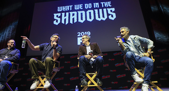 "NEW YORK - OCTOBER 7: (L-R) Moderator Alan Sepinwall, executive producers Jemaine Clement, Paul Simms and Taika Waititi speak at the panel for ""What We Do in the Shadows"" at the 2018 NY Comic-Con on October 7, 2018 in New York City. (Photo by Kena Betancur/Fox/PictureGroup)"