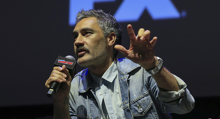 "NEW YORK - OCTOBER 7: Executive producer Taika Waititi speaks at the panel for ""What We Do in the Shadows"" at the 2018 NY Comic-Con on October 7, 2018 in New York City. (Photo by Kena Betancur/Fox/PictureGroup)"