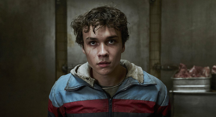 "DEADLY CLASS -- ""Reagan Youth"" Episode 100 -- Pictured: Benjamin Wadsworth as Marcus -- (Photo by: Allen Fraser/Syfy)"