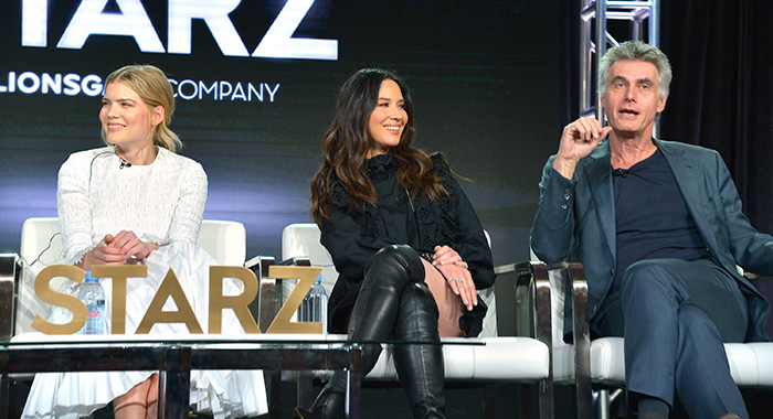 LOS ANGELES, CALIFORNIA - FEBRUARY 12: (L-R) Emma Greenwell, Olivia Munn and Stephen Garrett of 'The Rook' speak onstage during Starz 2019 Winter TCA Panel & All-Star After Party on February 12, 2019 in Los Angeles, California. (Photo by Charley Gallay/Getty Images for Starz)