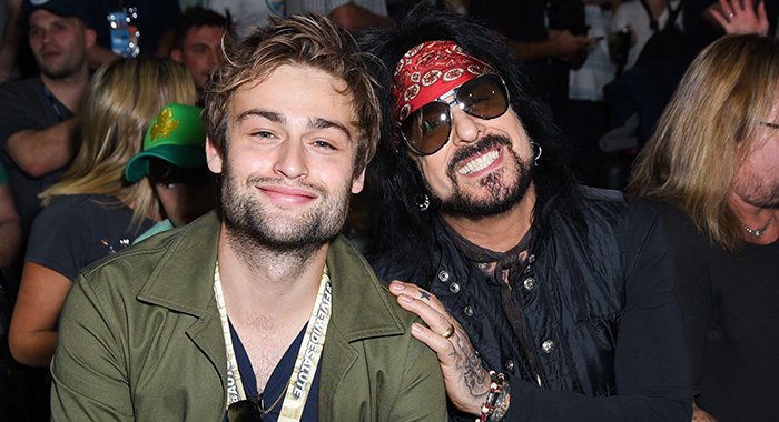 FONTANA, CA - MARCH 17: Douglas Booth and Nikki Sixx attend the Monster Energy NASCAR Cup Series race at Auto Club Speedway at Auto Club Speedway on March 17, 2019 in Fontana, California. (Photo by Presley Ann/Getty Images)