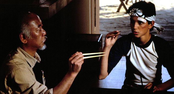 THE KARATE KID, Pat Morita, Ralph Macchio, 1984. ©Columbia Pictures/Courtesy Everett Collection