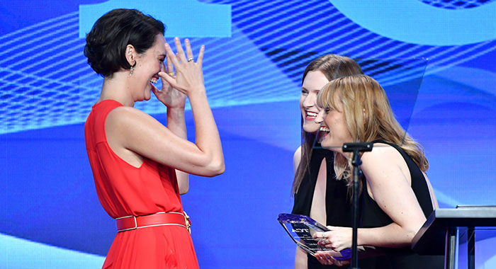 "BEVERLY HILLS, CALIFORNIA - AUGUST 03: Phoebe Waller-Bridge (L) accepts the Outstanding Achievement in Comedy Award for ""Fleabag"" onstage from Emma Dibdin and Laura Prudom during the TCA Awards at The Beverly Hilton Hotel on August 03, 2019 in Beverly Hills, California. (Photo by Amy Sussman/Getty Images)"