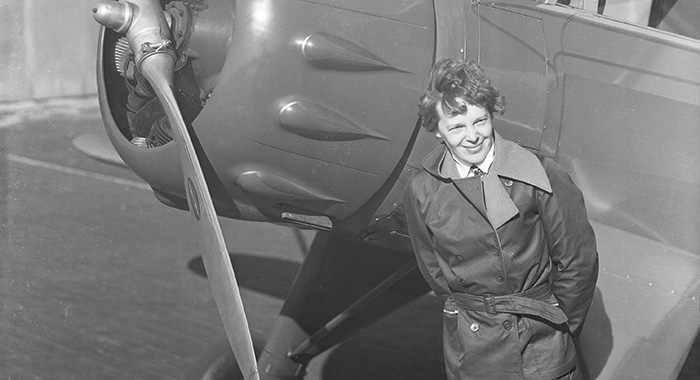 (Original Caption) Amelia Earhart, (1898-1937), American aviatrix, first woman to cross the Atlantic Ocean in an airplane. She stands next to the propeller of her plane. Undated photograph.