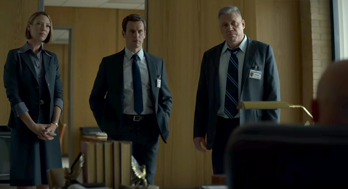 Anna Torv as Dr. Wendy Carr, Jonathan Groff as Holden Ford, and Holt McCallany as Bill Tench in Mindhunter season 2 trailer screencap (Netflix)