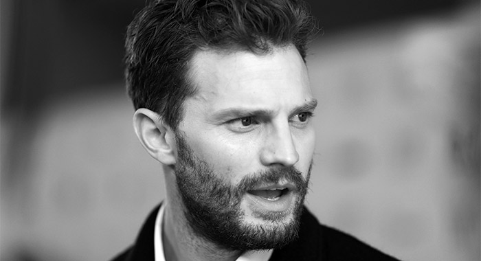 "TORONTO, ONTARIO - SEPTEMBER 07: (EDITORS NOTE: Image was shot in black and white. Color version not available.) Jamie Dornan attends the ""SYNCHRONIC"" premiere during the 2019 Toronto International Film Festival at Ryerson Theatre on September 07, 2019 in Toronto, Canada. (Photo by Joe Scarnici/Getty Images)"