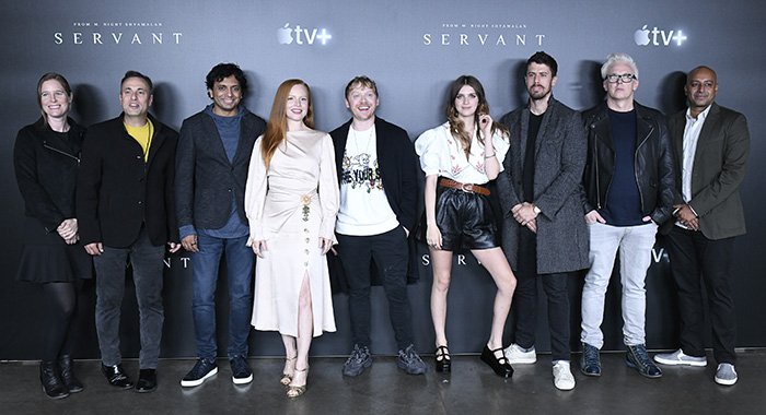 NEW YORK, NEW YORK - OCTOBER 03: R-L) M. Night Shyamalan, Lauren Ambrose, Rupert Grint, Nell Tiger Free, Toby Kebbell, Tony Basgallop and Ashwin Rajan attend Servant Panel during New York Comic Con at Hammerstein Ballroom on October 03, 2019 in New York City. (Photo by Eugene Gologursky/Getty Images for ReedPOP )