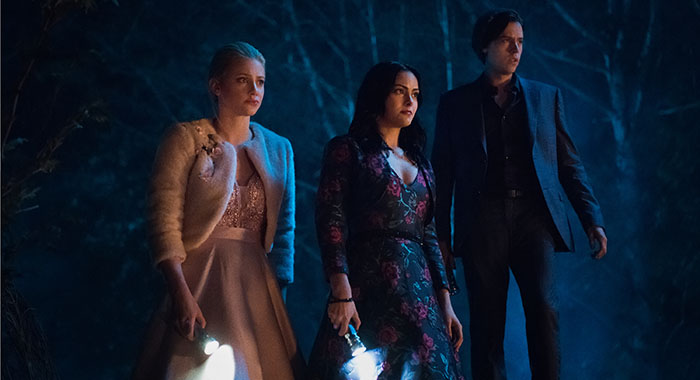 "Riverdale -- ""Chapter Fifty-Seven: Survive the Night"" -- Image Number: RVD322a_0293.jpg -- Pictured (L-R): Lili Reinhart as Betty, Camila Mendes as Veronica and Cole Sprouse as Jughead -- Photo: Dean Buscher/The CW"